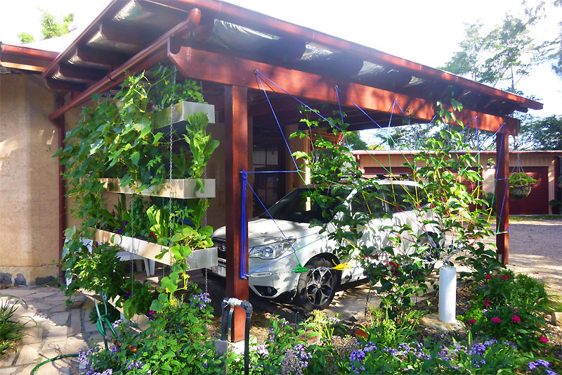 The carport with it's stainless steel food wall