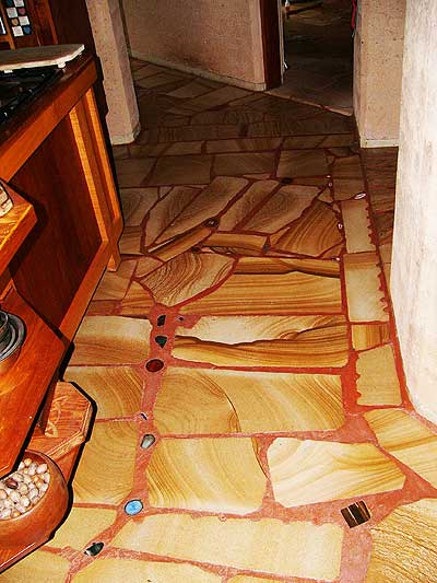inlaid gemstones add highlights to the sandstone floors